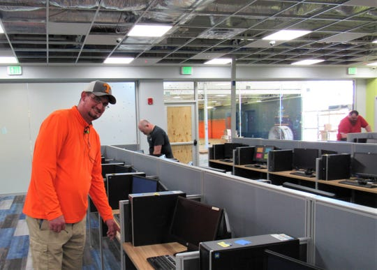 Site director Kelin Mock checks out a work station at the Sitel Call Center on Outlet Drive in Farragut before opening in May 2019.