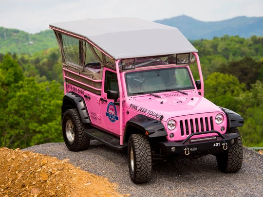 A Pink Jeep Tours Jeep on a display during a Pink Jeep Tours grand opening event held in Pigeon Forge on Thursday, April 25, 2019.