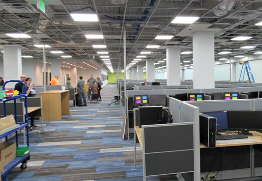 Staff members work inside to set up the infrastructure for the Sitel Call Center on Outlet Drive in Farragut.