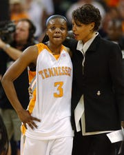 Tasha Butts is consoled by assistant coach Nikki Caldwell after Tennessee was defeated by UConn 70-61 in the NCAA women's basketball championship game on April 6, 2004, in New Orleans.