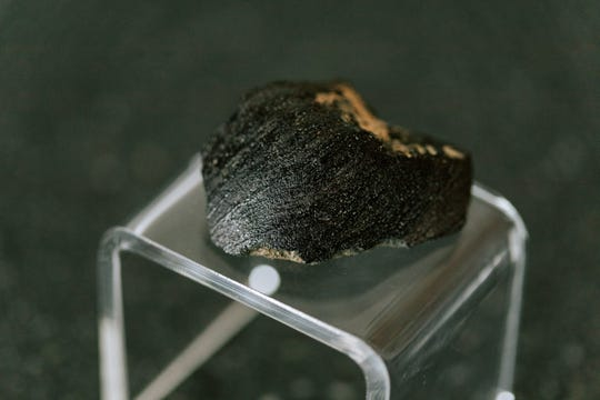 A chunk of the Lafayette Meteorite that once was hidden in a drawer in a lab at Purdue is back on the West Lafayette campus, on loan from the Field Museum in Chicago. The Martian meteorite, about two inches long, will be on display at the Neil Armstrong Hall of Engineering through Homecoming in October, starting April 29.