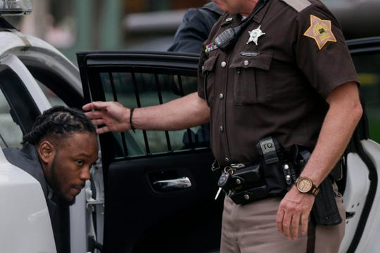 Deshay Hackner is escorted into the Tippecanoe County Courthouse by sheriff's deputies, Thursday, April 25, 2019, in Lafayette. Hackner is accused of killing Dewone Broomfield and Mary Woodruff in Vanderburgh County.