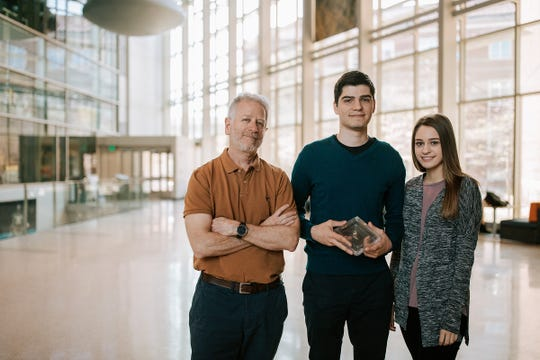 Purdue students Phillip Cozariuc, center, and Lauren Dilk, right, led a petition drive to return the Lafayette Meteorite to the West Lafayette campus after hearing Andy Freed, a Purdue professor of earth, atmospheric and planetary sciences, talk about the Martian meteorite. The rock is on loan from the Field Museum in Chicago, where it has been since 1929.