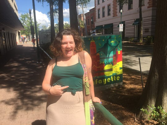 Kay Blanchard, 22, is a Lafayette native who is volunteering at this year's Festival International de Louisiane