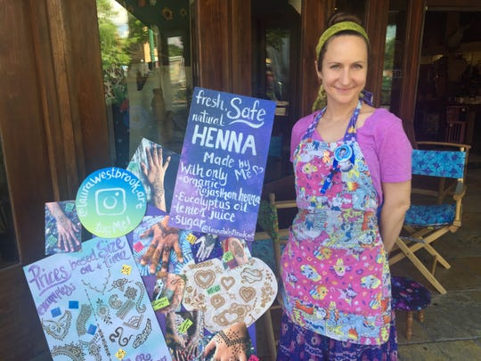 Laura Westbrook, 29, is a local Henna artist at this year's Festival International de Louisiane