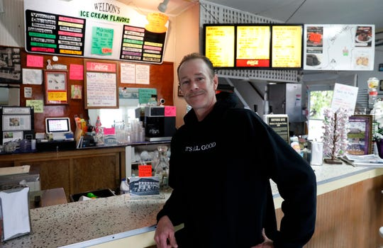 David Pierce sits in front of the counter at Weldon's Ice Cream in Millersport. The ice cream parlor and factory has been owned and operated by Pierce's family since the 1930s.