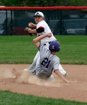 Liberty Union junior second baseman Brody Poston turns a double play against Bloom-Carroll during a 2019 game. The Loins were looking to have a huge year this season with eight returning starters.