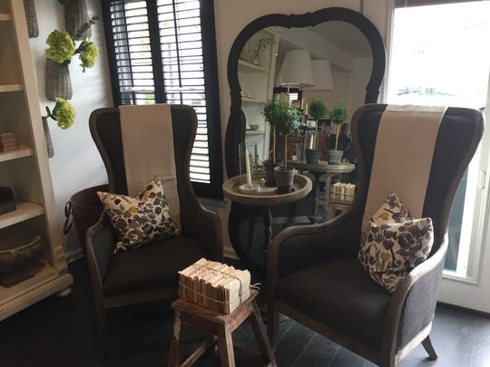 """Sage and Slate store owner Katelyn Lyders said she set up furniture and home decor items in """"vignettes,"""" like this arrangement seen Thursday, April 25, 2019, to give inspire customers' own interior designs."""