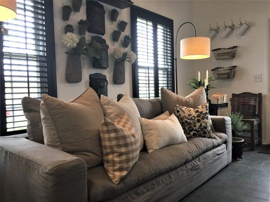 Handmade pillows by Howell resident Carli Helminen are among the home decor and one-of-a-kind items at new Howell shop Sage and Slate, shown Thursday, April 25, 2019.