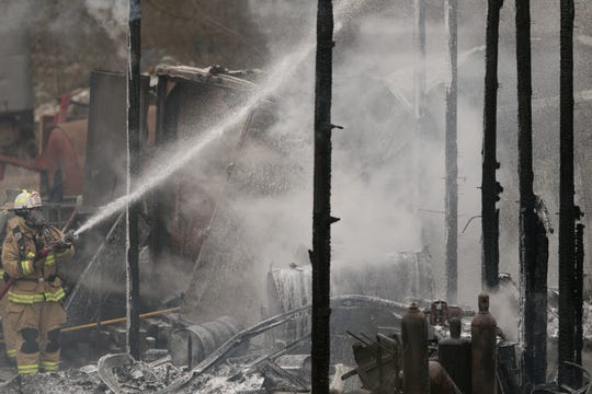 Firefighters from a number of departments work to put out a fire that erupted at a Green Oak business on Rushton Rd. Thursday, April 25, 2019. Neighbors heard a number of explosions.