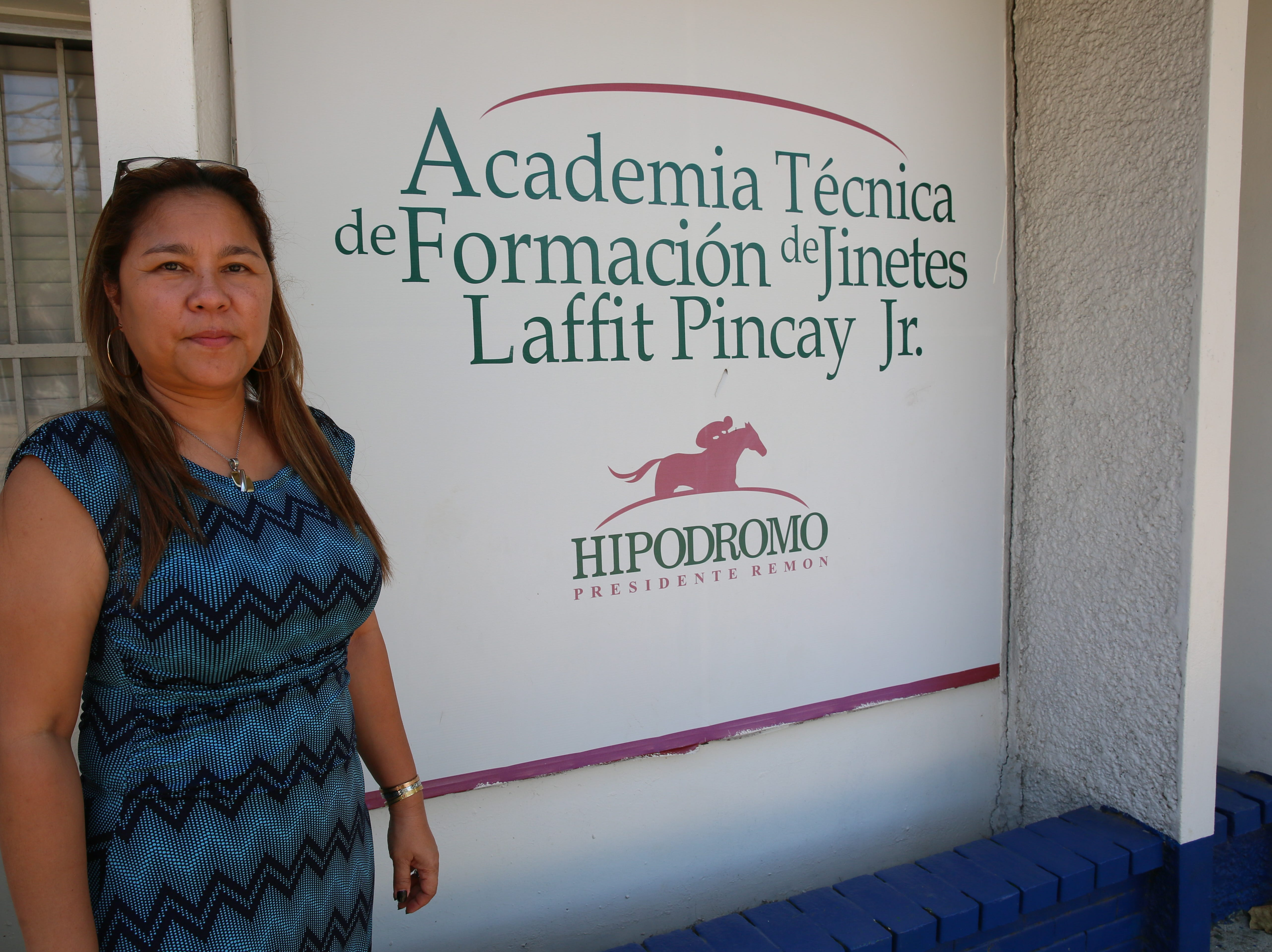 Graciela Yung Shing, director of the Laffit Pincay Jr. Technical Jockey Training Academy in Panama, oversees the 45 students and staff of teachers and former jockeys.