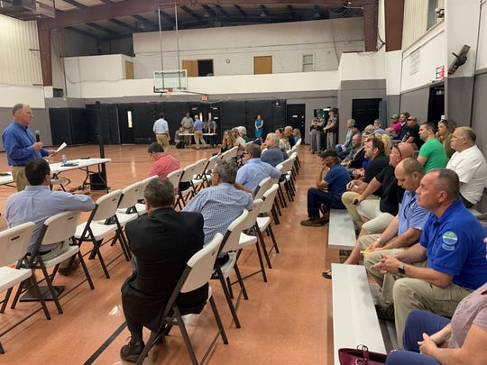 Jon Maybriar, director of the state's Division of Waste Management, talks to residents during a public meeting Wednesday night about the dumping of a concrete slurry that contaminated a creek in Bullitt County.