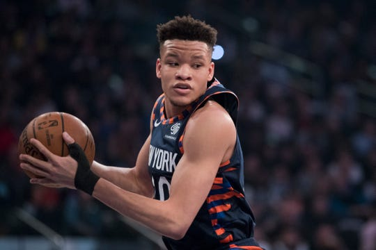 New York Knicks forward Kevin Knox grabs a rebound during the first half of an NBA basketball game against the Washington Wizards, Sunday, April 7, 2019, at Madison Square Garden in New York. (AP Photo/Mary Altaffer)