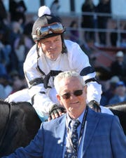 Jockey Jon Court and owner Willis Horton celebrate after Long Range Toddy won the Rebel Stakes on March 16 at Oaklawn Park in Hot Springs, Arkansas.