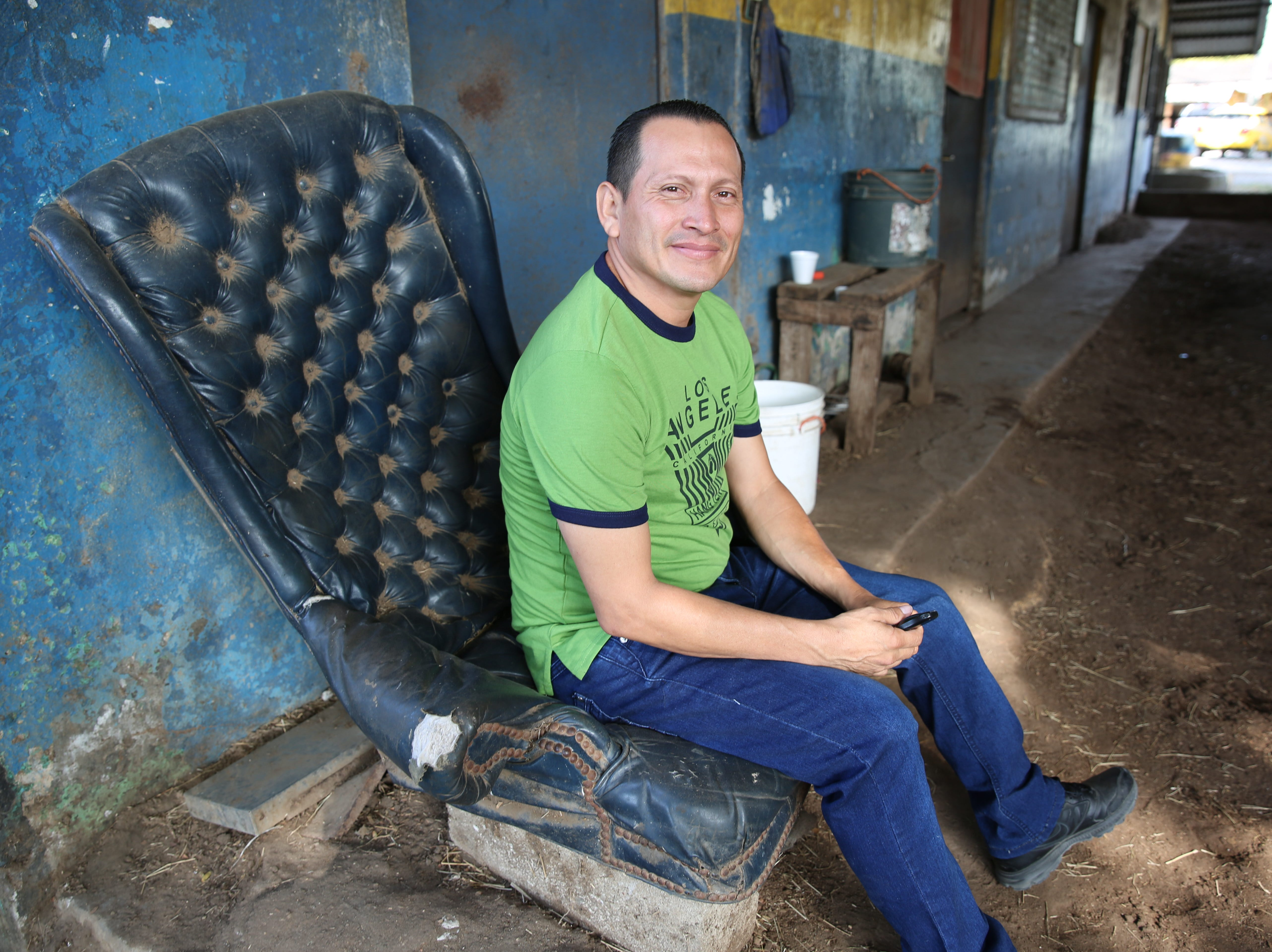 A former jockey who now trains students sits in the stables outside of Panama's only racetrack