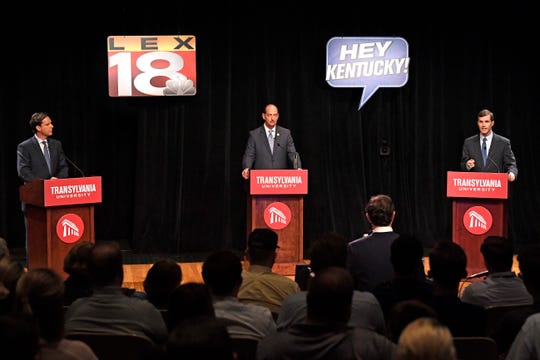 Democratic candidate for Kentucky governor, from left, former state Auditor Adam Edelen, Kentucky state Rep. Rocky Adkins, D-Sandy Hook, and Attorney General Andy Beshear on stage during a debate at Transylvania University in Lexington, Ky. April 24, 2019