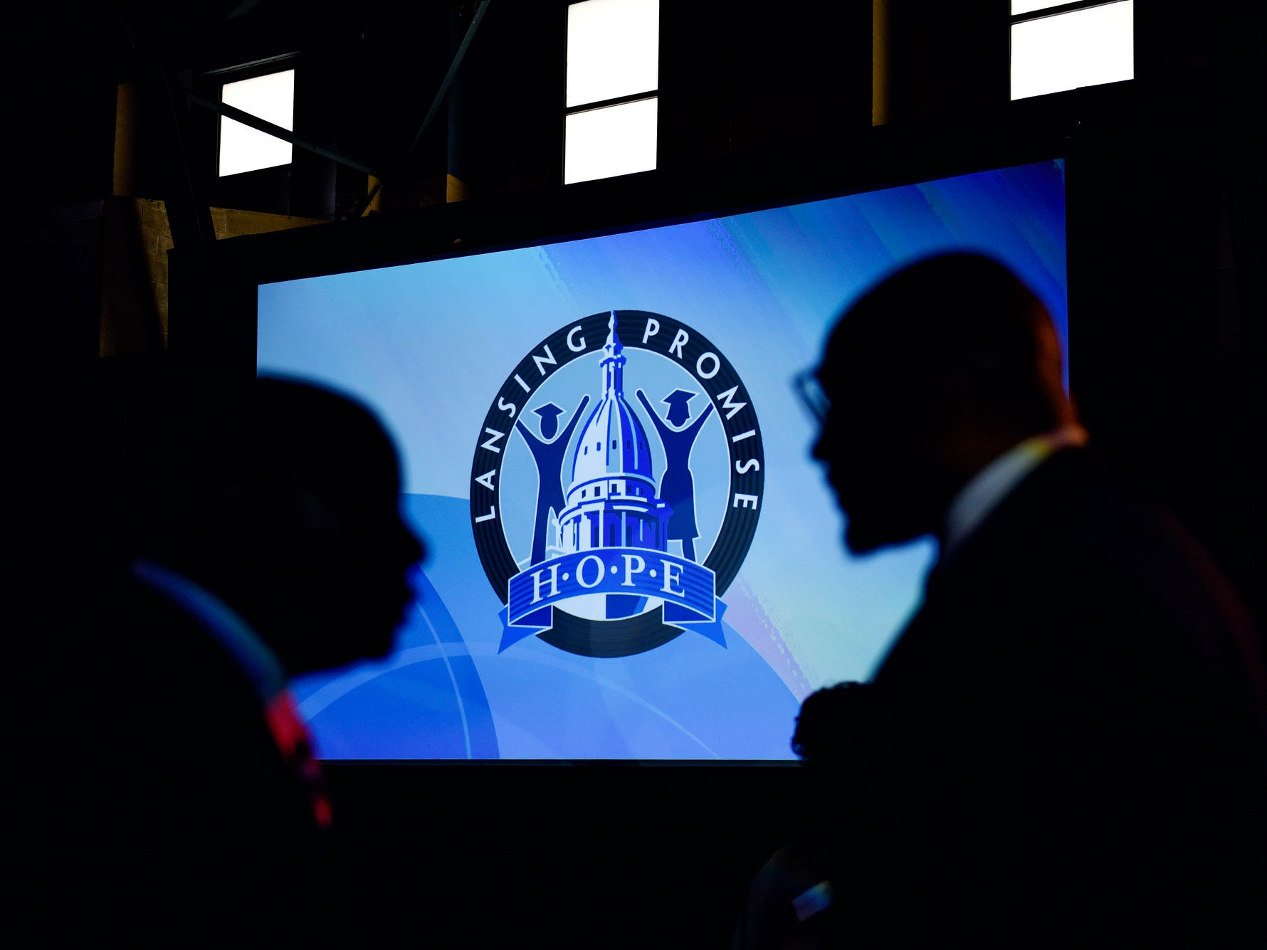 The Lansing Promise logo is displayed on a large screen during the fifth-annual Lansing Promise Dinner on Thursday, April 25, 2019, at the Don Johnson Fieldhouse in Lansing.