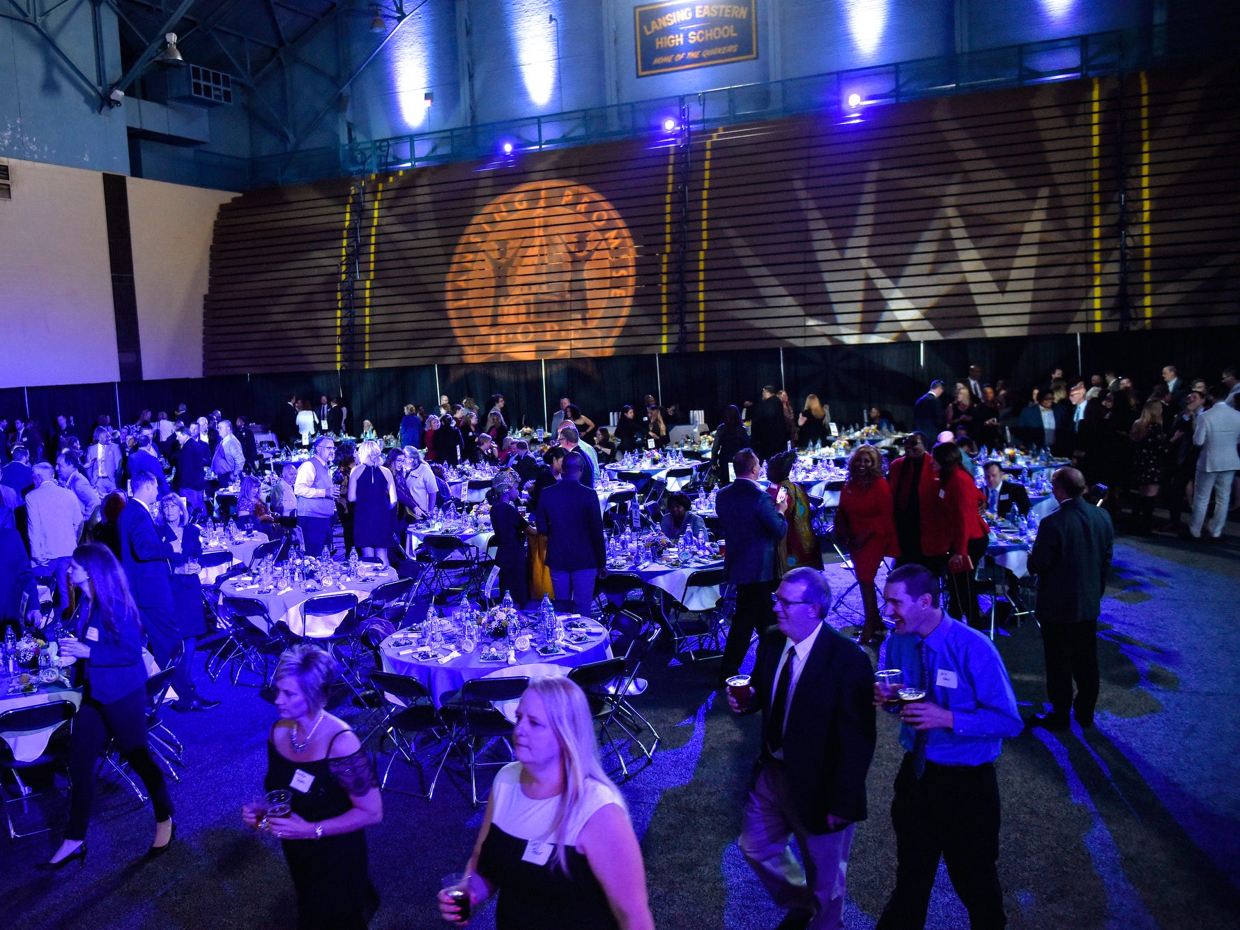Guests mingle during the fifth-annual Lansing Promise Dinner on Thursday, April 25, 2019, at the Don Johnson Fieldhouse in Lansing.