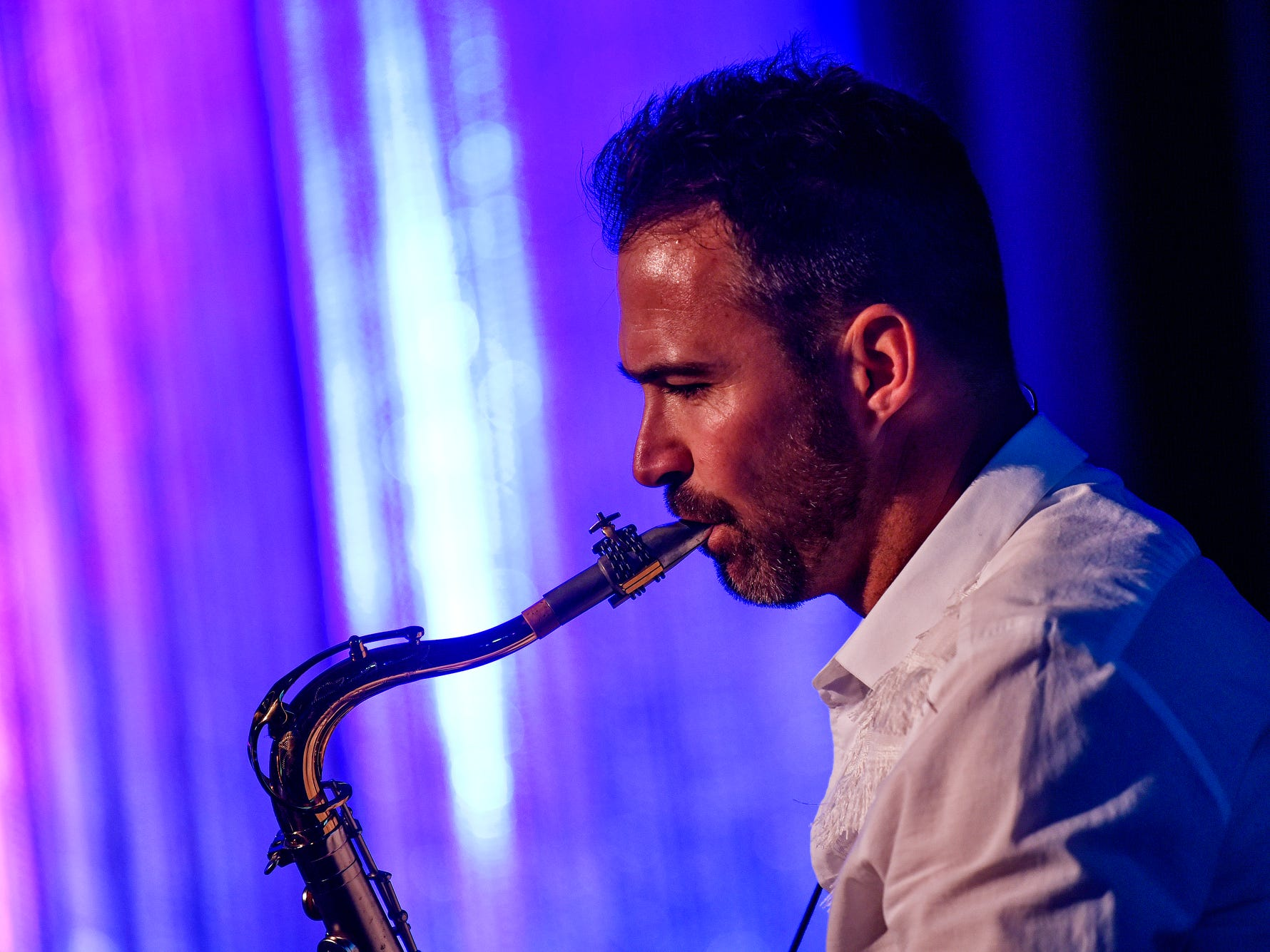 Saxophonist Phil Denny performs with a band during the fifth-annual Lansing Promise Dinner on Thursday, April 25, 2019, at the Don Johnson Fieldhouse in Lansing.