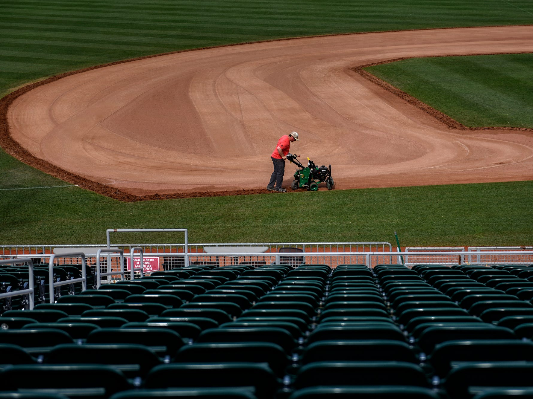 Lugnuts Head Groundskeeper Zach Severns rototills the edge of the infield dirt as he works to turnover the baseball field for a Lansing Ignite soccer match on Wednesday, April 24, 2019, at Cooley Law School Stadium in Lansing.