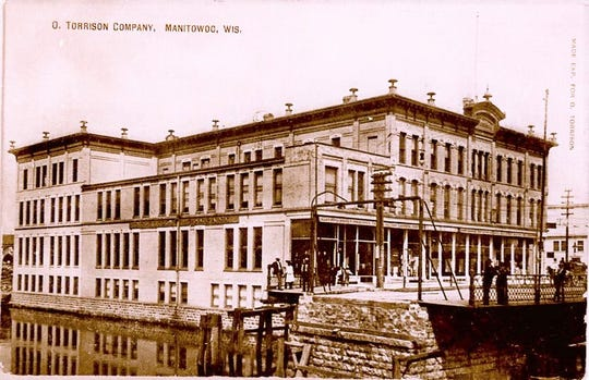 O. Torrison store, Manitowoc. The Eighth Street swing bridge is open and no crossing barriers. Circa 1890.