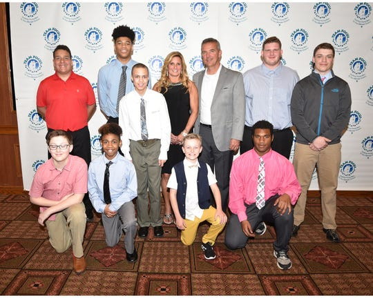 Former Ohio State football coach Urban Meyer and his wife Shelley with some of the fatherless young men who have been mentored by Team Focus, an organization founded 19 years ago by Crestline natives Mike and Mickey Gottfried.