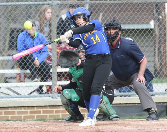 Ontario's Claire Henige rips a single during the Lady Warriors 7-5 loss to Clear Fork on Wednesday.