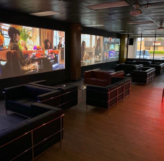 Next Level Sports & Cigar Bar has oversized screens for watching the big game.