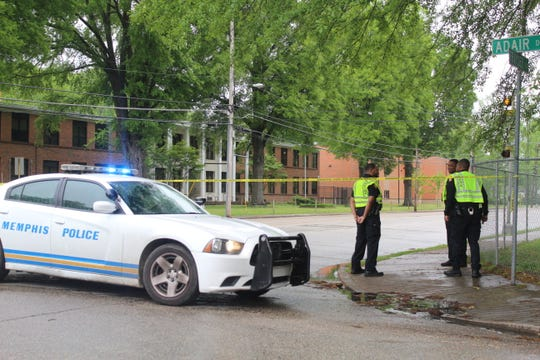 Memphis police officers stand outside of Adair Drive and Frayser Boulevard on Thursday, April 25, after a truck struck three children leaving them in critical condition. Officers believe the driver was having a medical emergency before the crash.