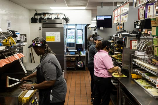 McDonald's staff members work inside of Steve Jeffers' Lakeland McDonald's location on Thursday, April 25, 2019.