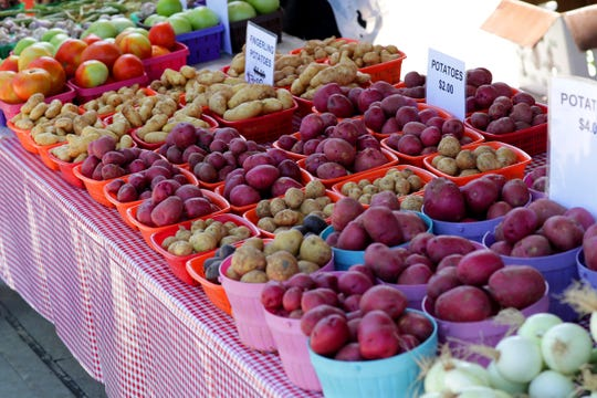 Peak market time offers a colorful array of produce, such as these potatoes at the West Allis market stand of Yang Family Farm in Hartford.