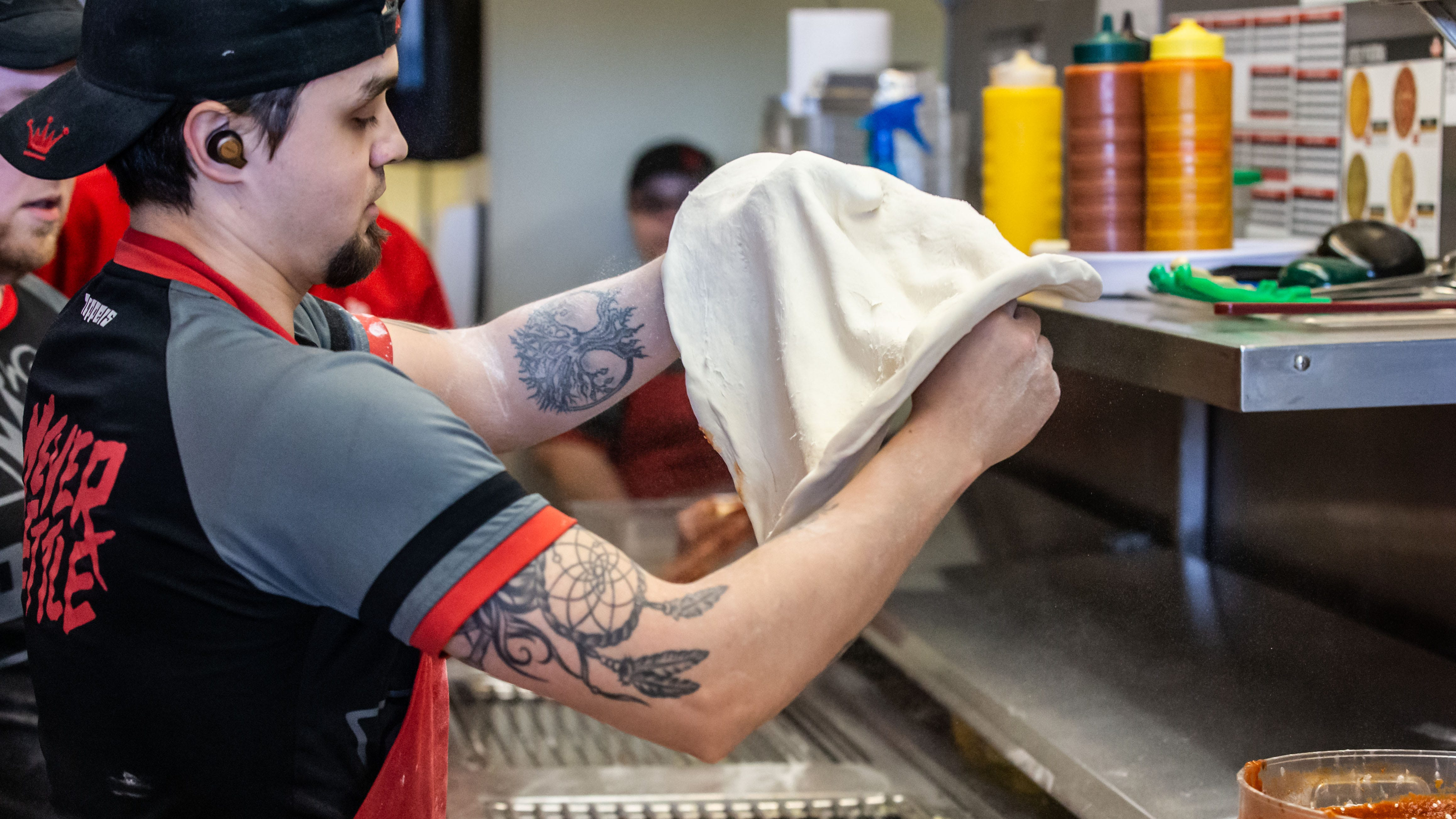 Toppers Pizza employees compete in Skin Sprints, fastest pizza-maker contest