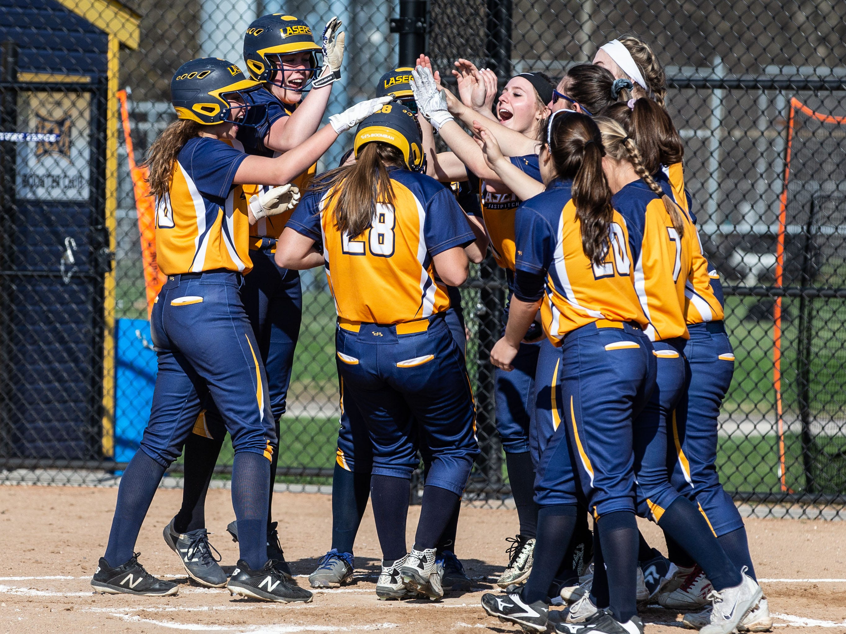 Kettle Moraine's Claudia Spencer (28) receives a hero's welcome after hitting a home run in the game against Sussex Hamilton on Wednesday, April 24, 2019.