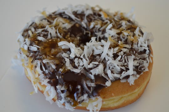 The caramel delight doughnut tastes like Samoas Girl Scout Cookies, said Bobby Kaid, co-owner of Donut Squad.