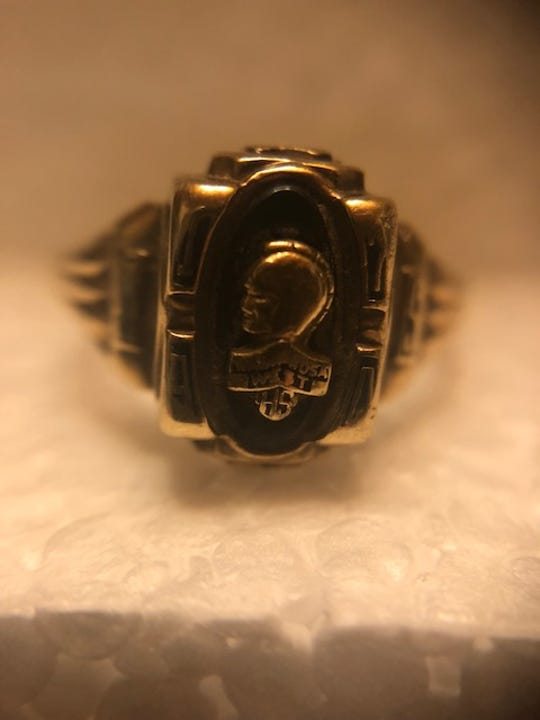 "Wauwatosa West High School class ring found in IL.  The stone is a very dark shade of green. The initials ""MS"" were engraved on the sides of the ring. The year is either 1970 or 1974."