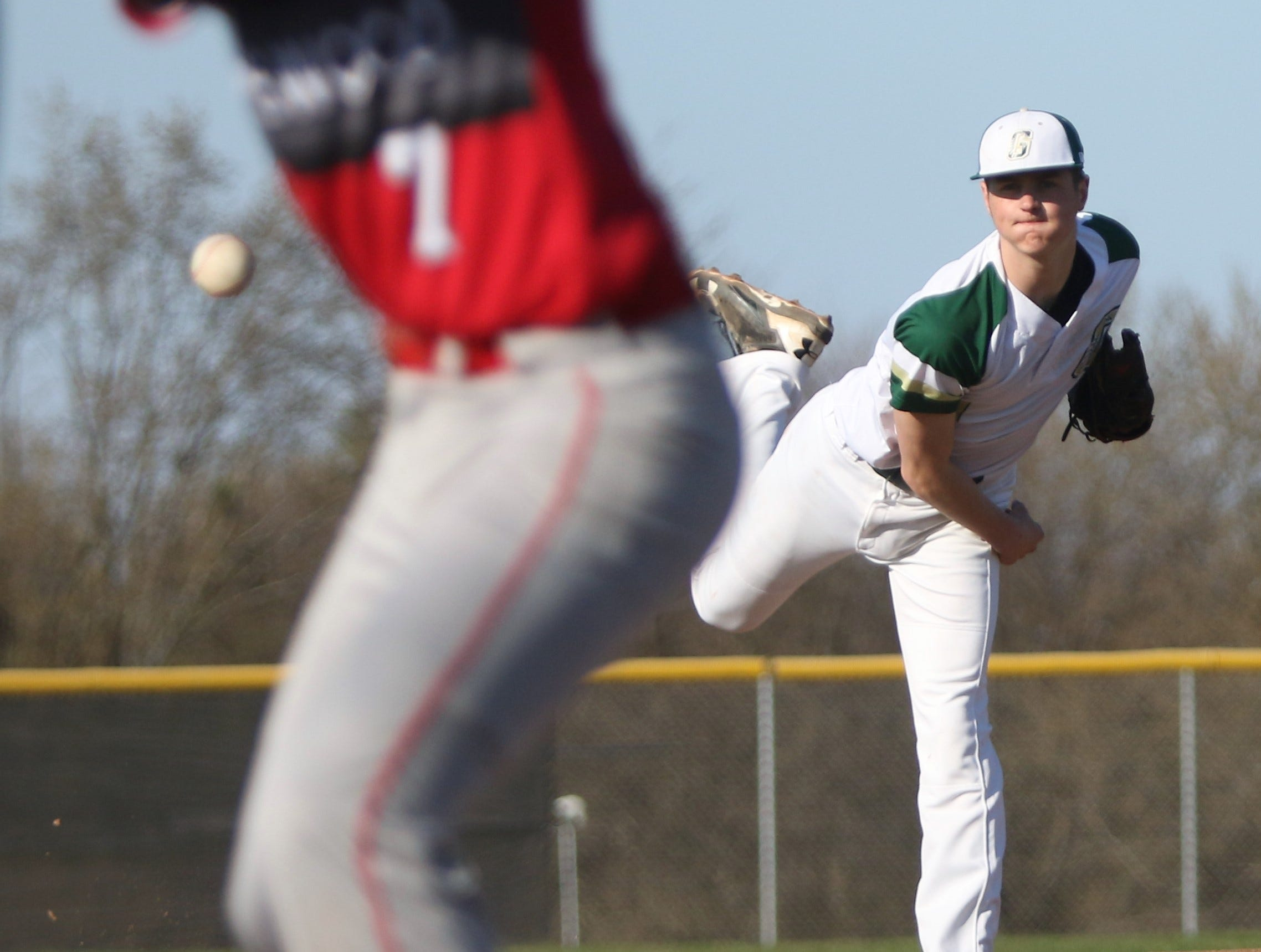 Greenfield pitcher Tyler Graf watches as his delivery heads toward home plate against Shorewood on April 24, 2019.