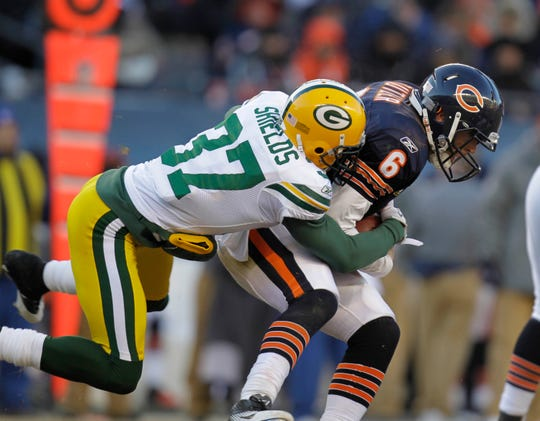 2011: Green Bay Packers cornerback Sam Shields (37) sacks Chicago Bears quarterback Jay Cutler (6) during the NFC Championship game between the Green Bay Packers and the Chicago Bears at Soldier Field in Chicago.