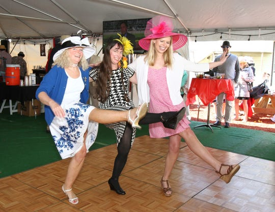 From left, Jenny Nelson, Nancy Shue, and Ann Wallace kick up their heels to the Beer Barrel Polka at a Maxie's Derby Day party.