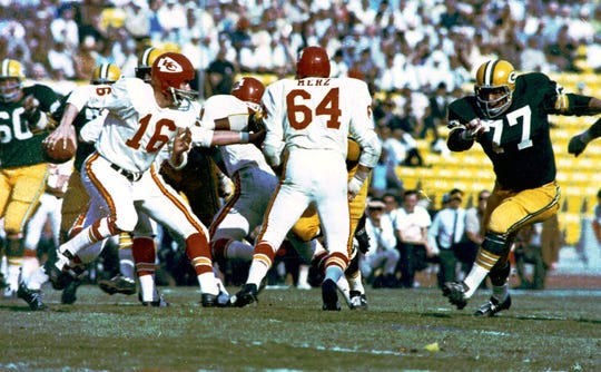 Kansas City Chiefs quarterback Len Dawson (16) looks for an opening during Super Bowl I game against the Green Bay Packers at Memorial Coliseum in Los Angeles. The Packers won, 35-10.