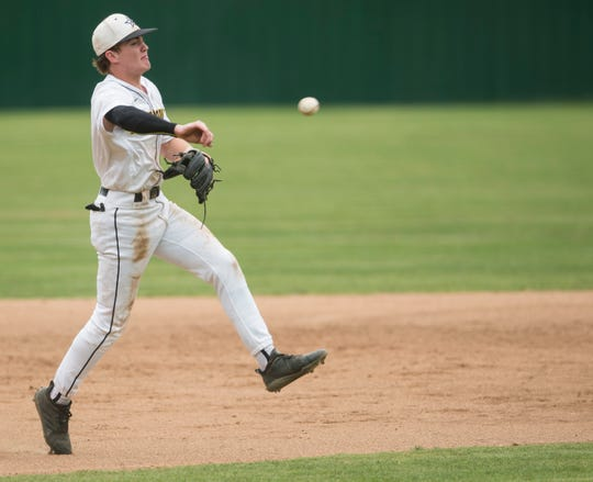 Autauga's Tyson Tubbs (2) throws to first base at Autauga Academy High School in Prattville, Ala., on Thursday, April 25, 2019. Autauga defeated Clarke Prep 4-3 with a walk-off home run in the first game of a doubleheader.