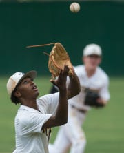 Autauga's Kyrin Long (3) brings down a bouncing dead ball at Autauga Academy High School in Prattville, Ala., on Thursday, April 25, 2019. Autauga defeated Clarke Prep 4-3 with a walk-off home run in the first game of a doubleheader.