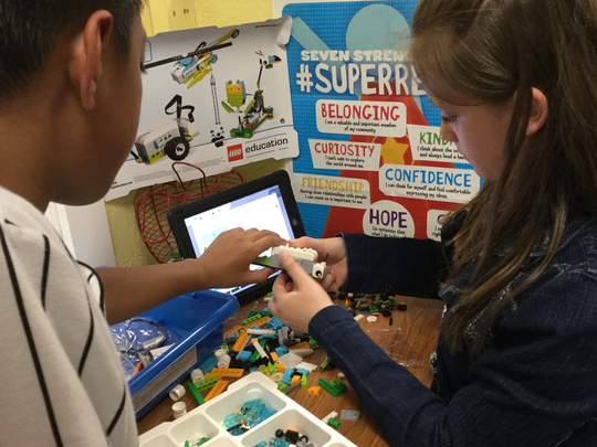 Yorktown Elementary School students in Randy Reffett's fourth-grade class use Legos with additional science materials to create simple machines that are programmed using a coding app on an iPad. The Legos and materials  were purchased with support of a Robert P. Bell Education Grant.