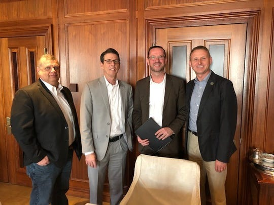 James King (Delaware County Commissioner), Bill Walters (Director of the ECI Regional Planning District), Thomas Schwegmann (CEO PONS Atlantic Partners in Berlin), and  Brad Bookout (Director of Municipal and Economic Affairs in Delaware County) take a quick photo during their seven day trip to Germany and the Netherlands.