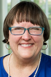 Dr. Judith Iriarte-Gross, chemistry professor, director of the Women In STEM (WISTEM) Center at MTSU, and founder and director of Tennessee's first Expanding Your Horizons girls' STEM education workshop.
