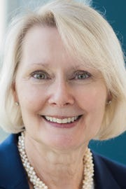Christine_Karbowiak. a member of MTSU's Board of Trustees and executive vice president, chief administrative officer and chief risk officer of Bridgestone Americas Inc.