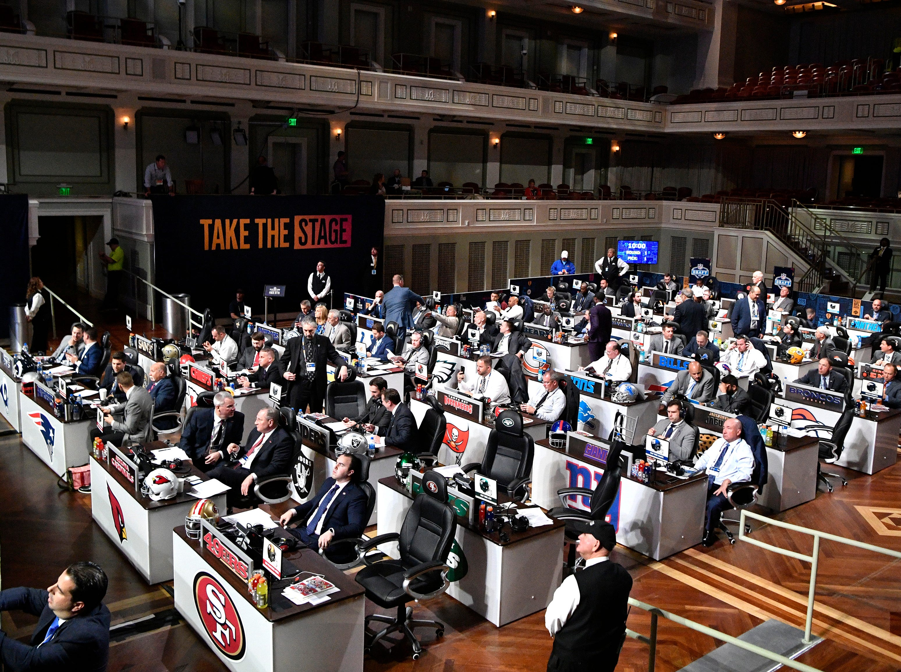 NFL team officials wait to make their picks in the first round of the NFL Draft at the Schermerhorn Symphony Center Thursday, April 25, 2019, in Nashville, Tenn.