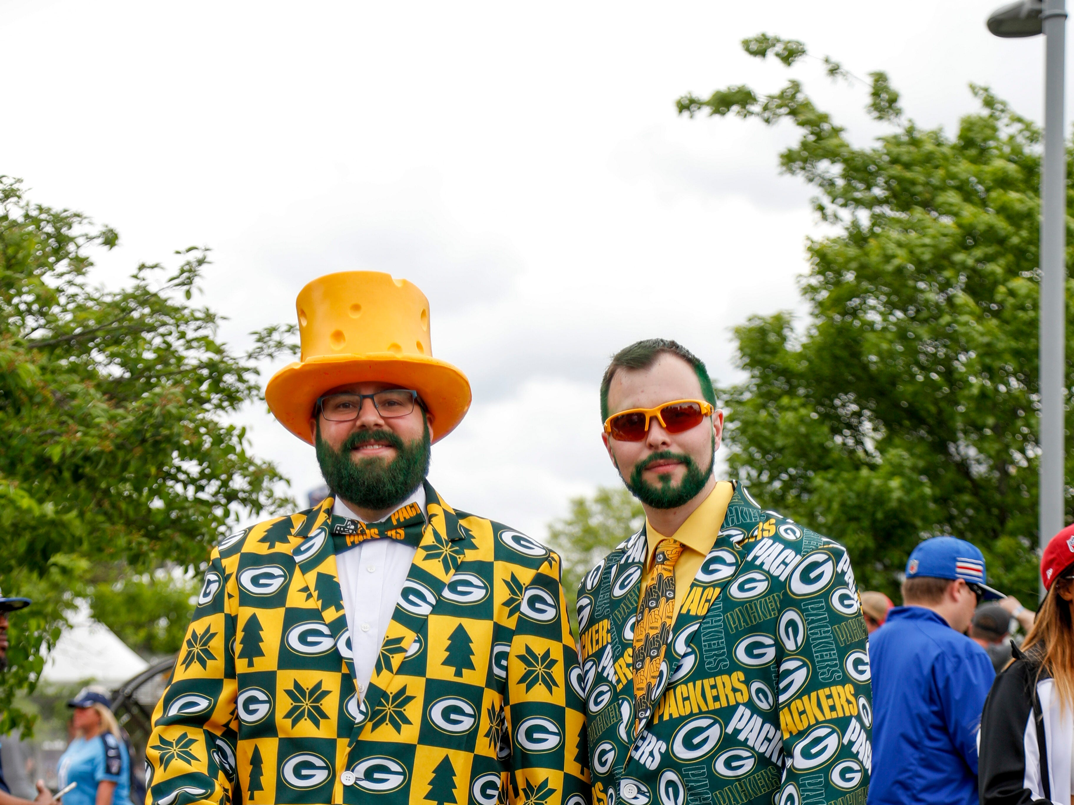 Packers fans pose in full dapper attire during the NFL Draft Experience at Nissan Stadium in Nashville, Tenn., on Thursday, April 25, 2019.