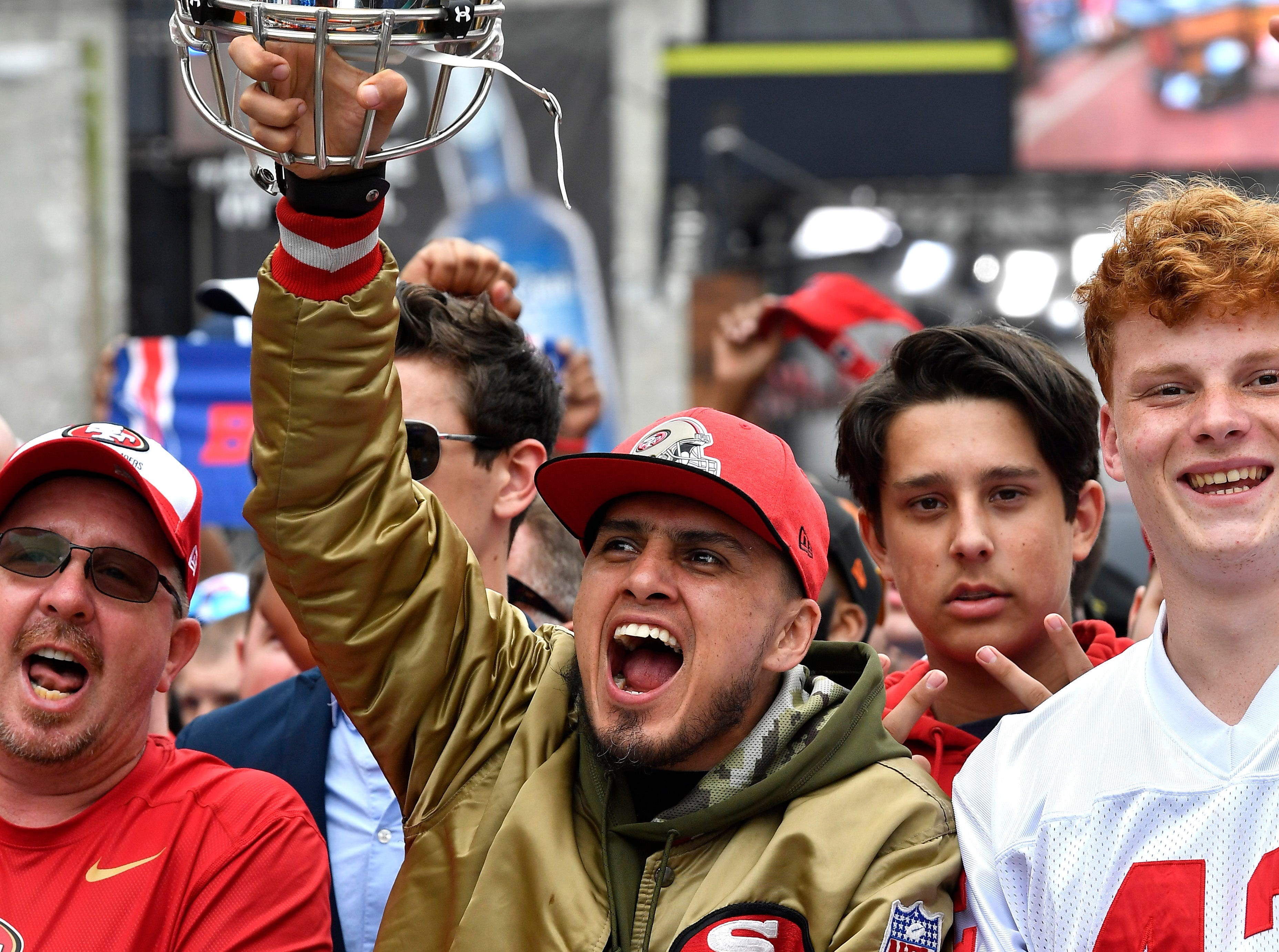 Niners fan Christian Caballero of Mexico City cheers before the start of the first round of the NFL Draft  Thursday, April 25, 2019 in Nashville, Tenn.