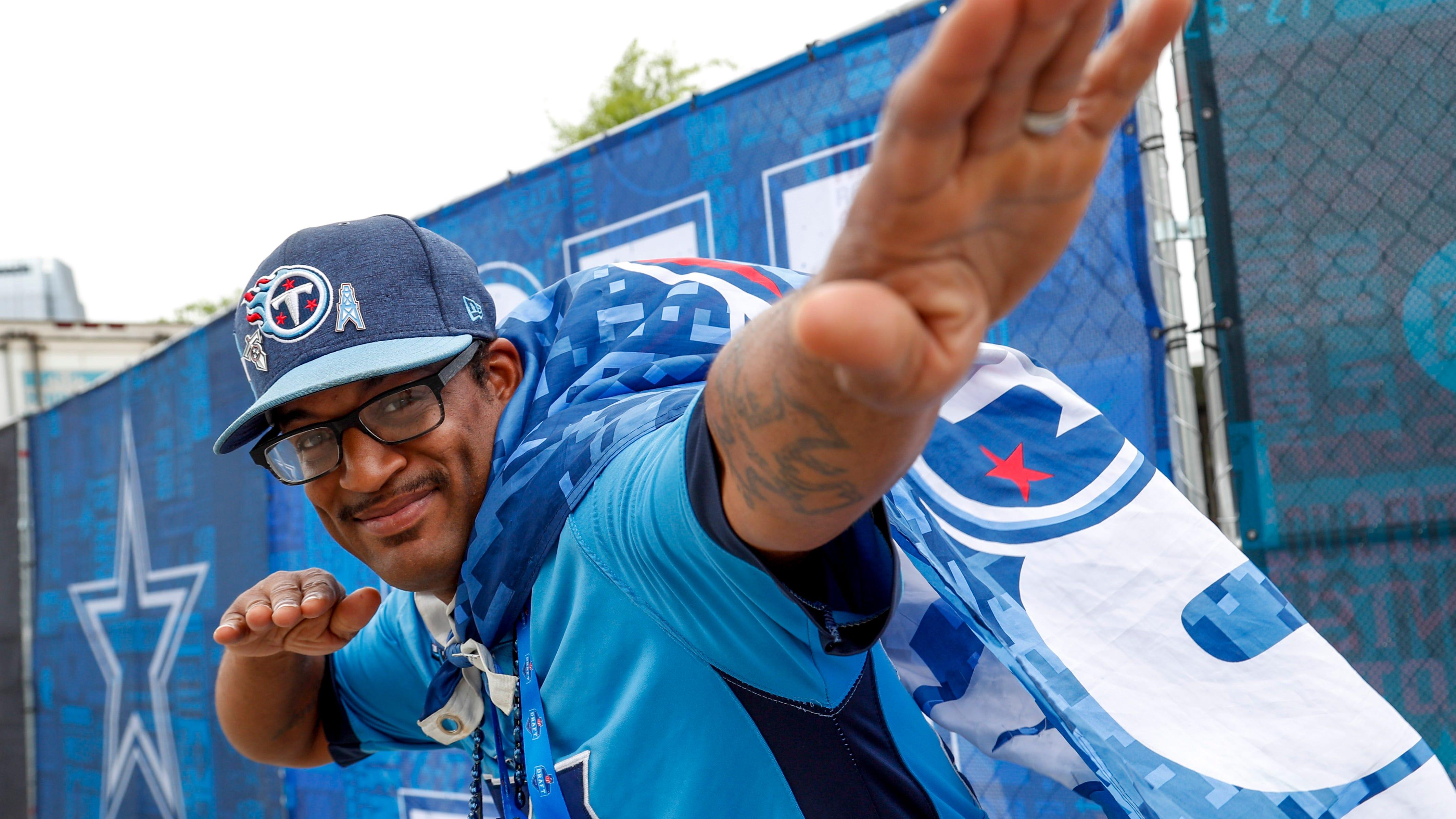 Antonio Osborne strikes a pose in full Titans garb during the NFL Draft Experience at Nissan Stadium in Nashville, Tenn., on Thursday, April 25, 2019.