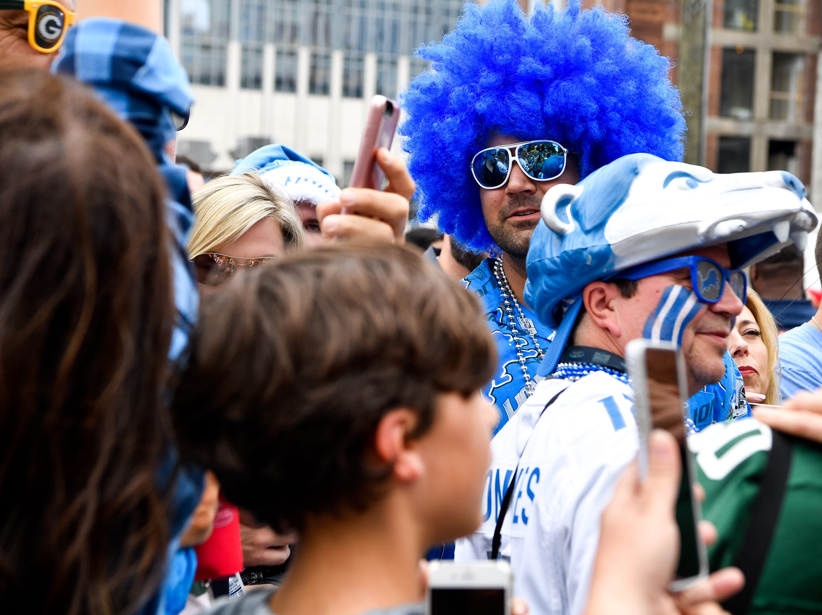 Ben Broumand wears a blue afro for the Lions along Lower Broadway during the NFL Draft Thursday, April 25, 2019, in Nashville, Tenn.